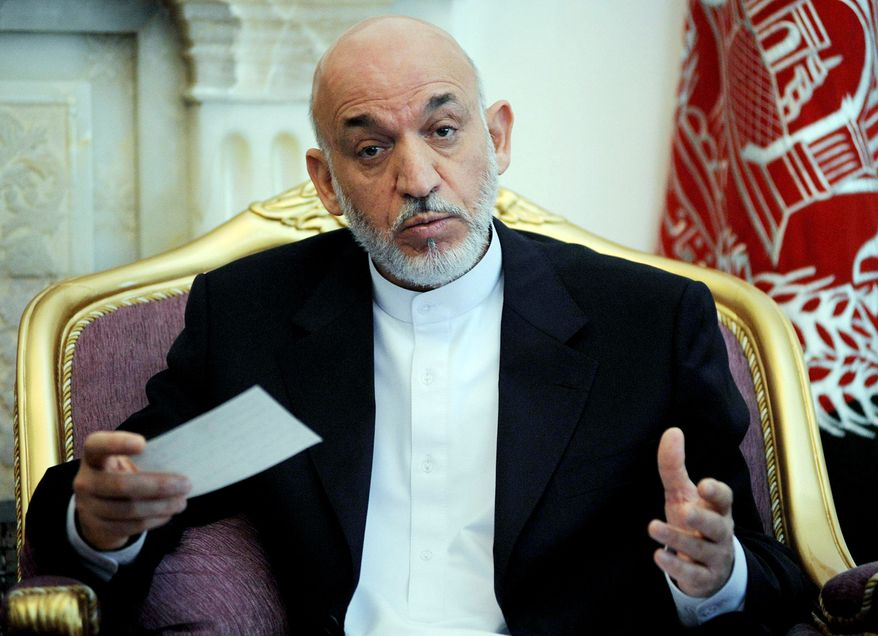 Afghan President Hamid Karzai says he decided to ban private security firms in his country because they were contributing to corruption. (Associated Press)