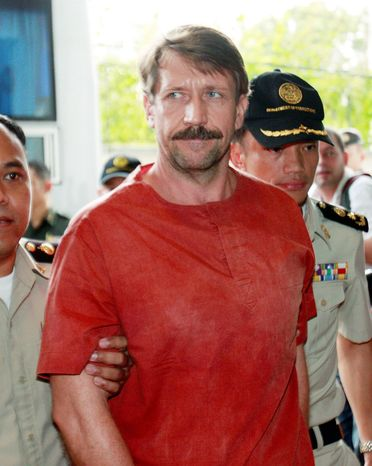 Viktor Bout, a suspected Russian arms dealer, arrives at court in Bangkok on Friday to hear an appeals court extradition decision requested by the U
