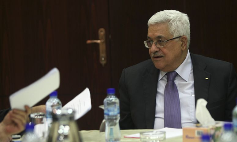 Palestinian Authority President Mahmoud Abbas attends a meeting of the Palestinian Liberation Organization (PLO) executive committee at his headquarters in the West Bank town of Ramallah, Friday, Aug. 20, 2010. Israel and the Palestinians will resume long-stalled direct peace talks in Washington early next month with the aim of reaching a settlement in a year's time, Secretary of State Hillary Rodham Clinton said Friday.(AP Photo/Atef Safadi, Pool)