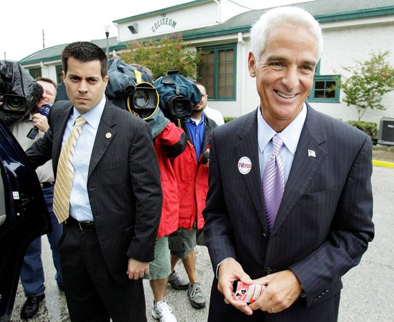 Associated Press Florida Gov. Charlie Crist, independent candidate for Senate, speaks to reporters after voting in St. Petersburg.