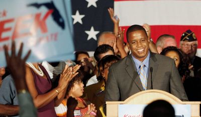 Associated Press Florida Democratic Senate nominee Kendrick B. Meek savors the moment as supporters chant the four-term congressman's name in Hollywood, Fla., at his victory party.