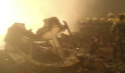 In this cell phone photo released by China's Xinhua news agency, rescuers work at the site of a reported plane crash at an airport in northeast China's Heilongjiang province on Aug. 24, 2010. According to Xinhua, the plane overshot the runway in Yichun city and burst into flames. (Associated Press)