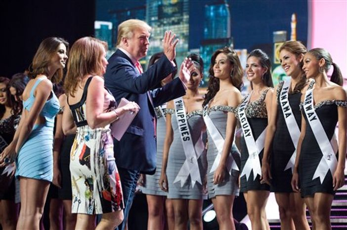 In this photo provided by the Miss Universe Organization, co-owner of the Miss Universe Pageant, Donald J. Trump,  talks with Venus Raj, Miss Philippines 2010; Giuliana Zevallos, Miss Peru 2010; Yohana Benitez Olmedo, Miss Paraguay 2010; Anyoli Abrego, Miss Panama 2010, and Melinda Elvenes, Miss Norway 2010, at Mandalay Bay Hotel and Casino in Las Vegas, Nev. on Sunday, Aug