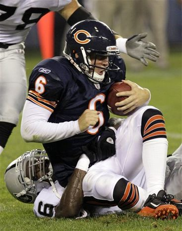Chicago Bears quarterback Jay Cutler (6) is sacked Oakland Raiders linebacker Kamerion Wimbley, bottom, in the first half of a preseason NFL football game in Chicago, Saturday, Aug. 21, 2010. (AP Photo/Charles Rex Arbog