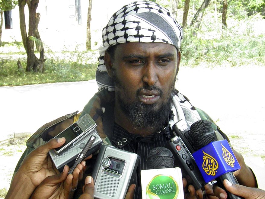 "Sheik Ali Mohamud Rage, a spokesman for the al-Shabab militia,Tuesday, Aug. 24, 2010, in Mogadishu, Somalia, who said that members of the group's ""special forces"" had carried out the attack against those ""aiding the infidels."" Scores of people were killed during the attack. (AP Photo/Mohamed Olad Hassan)"