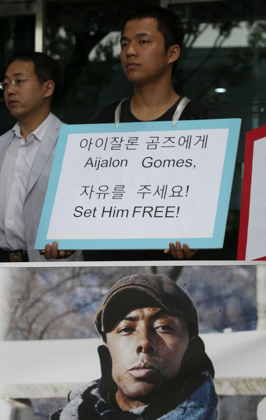South Korean human rights activists participate in a rally demanding release of American Aijalon Mahli Gomes in North Korea, in front of the United Nations High Commissioner for Refugees Korea Representative Office in Seoul Monday, July 26, 2010. The rally marked six month after Mr. Gomes was arrested in North Korea on Jan. 25. (AP Photo/Ahn Young-joon)