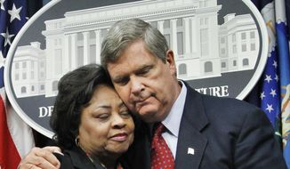 Agriculture Secretary Tom Vilsack, right, puts his arm around former Agriculture Department official Shirley Sherrod, left, as they conclude a press conference at the Agriculture Department in Washington, Tuesday, Aug. 24, 2010. Mrs. Sherrod, the Agriculture Department official ousted during a racial firestorm last month, declined Tuesday to return to the agency, though she said it was tempting. (AP Photo/Manuel Balce Ceneta)