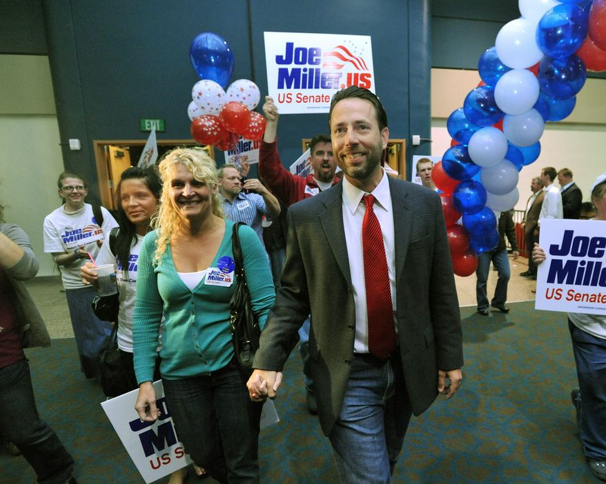 ASSOCIATED PRESS Joe Miller, Republican candidate for U.S. Senate, and his wife, Kathleen, enter election central in Anchorage, Alaska, on Tuesday. Returns showed Mr. Miller ahead of incumbent Sen. Lisa Murkowski.
