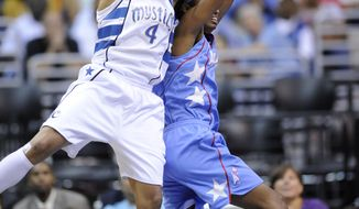 ASSOCIATED PRESS Washington Mystics' Marissa Coleman (4) fights for the ball against Atlanta Dream's Angel McCoughtry, right, during the first half of an WNBA playoff basketball game, Wednesday, Aug. 25, 2010, in Washington.