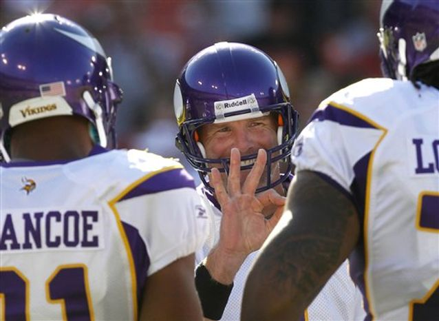 Minnesota Vikings quarterback Brett Favre, center, signals in the huddle in the first quarter of an NFL preseason football game against the San Francisco 49ers in San Francisco, Sunday, Aug. 22, 2010. (AP Photo/Tony Avelar)