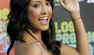 "FILE - This Oct. 15, 2009 file photo shows singer Fernanda Romero arriving at the ""Los Premios MTV 2009"" in Universal City, Calif. (AP Photo/Chris Pizzello, File)"