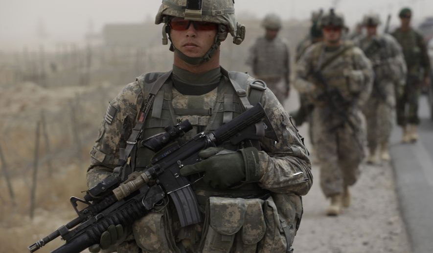 U.S. Army Spc. David Zink, of Leavenworth, Kan., of Tactical Command Post, HQ Company, 2-502 Infantry, 101st Airborne Division, walks with platoon-mates during a joint patrol with the Afghan Army, in Zhari district, Kandahar province, southern Afghanistan, Wednesday Aug. 25, 2010. Soldiers in Zhari operate in a district which is the birthplace of the Taliban movement, and holds many well-armed insurgents who blend in with a support network providing them with explosives and safe havens. (AP Photo/Brennan Linsley)