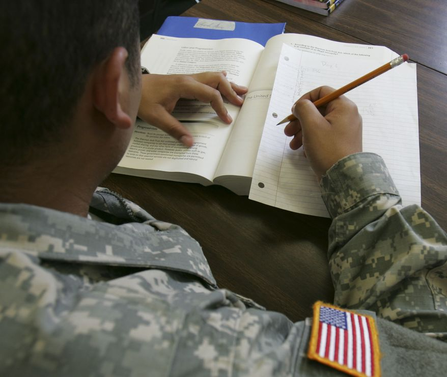 ** FILE ** In 2008, Army Pvt. Edurado Arceo of Pamona, Ca. studies for his General Educational Development certificate in a new Army program dedicated to helping high school dropouts earn their GEDs before they move on to basic training at Fort Jackson, S.C. (AP Photo/Mary Ann Chastain, File)
