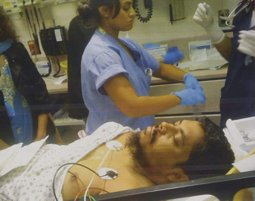 This undated photograph provided by the New York Taxi Workers Alliance shows taxi driver Ahmed H. Sharif in a hospital in New York. A drunken passenger riding in a New York City taxi cab attacked the driver after asking him if he was Muslim, police said. Mr. Sharif was treated for cuts to the throat, upper lip, forearm and thumb. (AP Photo/New York Taxi Workers Alliance)