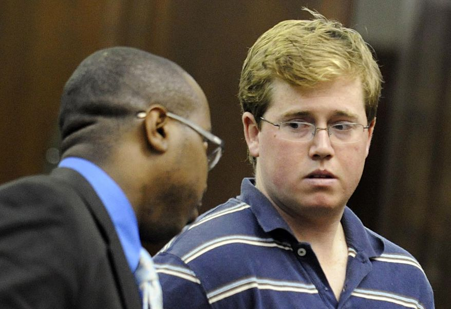 Michael Enright, right, confers with his attorney Jason Martin, during his arraignment in a New York City courtroom on charges that include attempted murder as a hate crime, Wednesday, Aug. 25, 2010. Mr. Enright is accused of slashing taxi driver Ahmed H. Sharif with a hand tool on Tuesday, Aug. 24, after the driver said he was Muslim. (AP Photo/Steven Hirsch, Pool)