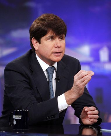 """Former Illinois Gov. Rod Blagojevich talks with Jon Stewart during an appearance on Comedy Central's """"The Daily Show with Jon Stewart"""" Monday, Aug. 23, 2010 in New York. (AP Photo/Jason DeCrow)"""