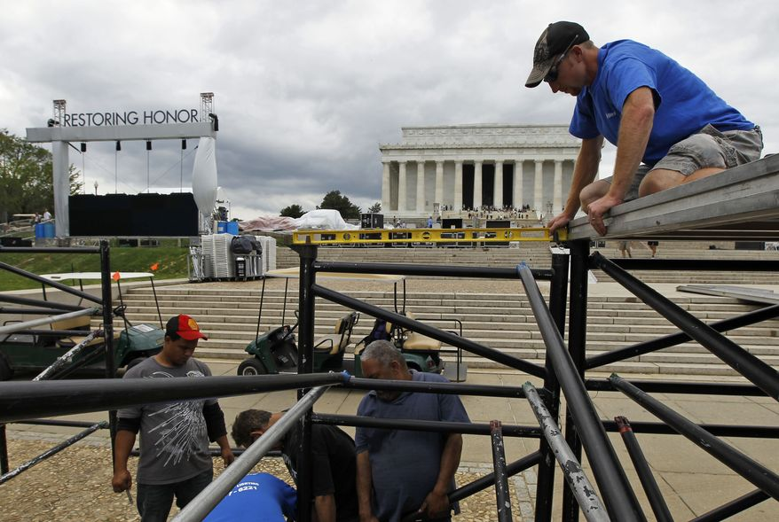 """Ryan Palmer (right) with Elite Productions uses a level as the stage is being constructed on Wednesday, Aug. 25, 2010, for the Glenn Beck """"Restoring Honor"""" rally in front of the Lincoln Memorial in Washington. Mr. Beck's rally on the anniversary and at the site of Martin Luther King Jr.'s famous """"I Have a Dream"""" speech is drawing criticism, protests and questions about his intentions. (AP Photo/Alex Brandon)"""