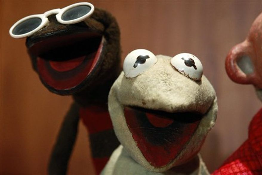 """Ten character's from """"Sam and Friends,"""" some of Jim Henson's early puppets, including the original Kermit, are donated to the Smithsonian Institution, during a ceremony at the National Museum of American History, in Washington, on Wednesday, Aug. 25, 2010. (AP Photo/Jacquelyn Martin)"""