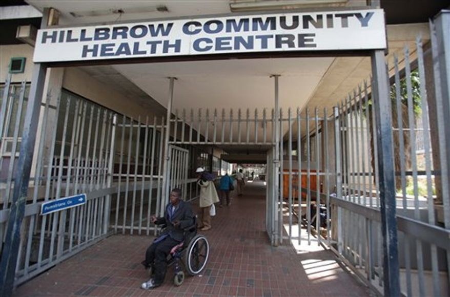 A woman leaves the almost deserted Hillbrow Community Health Center in Johannesburg, Wednesday, Aug. 25, 2010. Doctors and activists say AIDS patients aren't getting treated because of a nationwide strike in the country, which has the highest incidence of the virus that causes AIDS. (AP Photo/Denis Farrell)