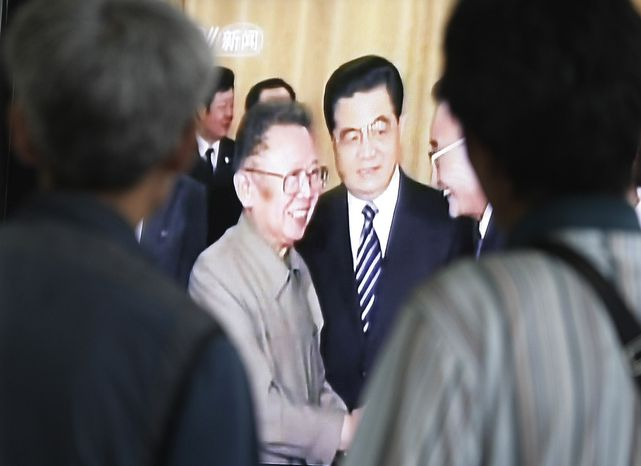 South Koreans watch a TV broadcasting file footage of North Korean leader Kim Jong-il, center left, accompanied by Chinese President Hu Jintao, center, in their meeting, at a railway station in Seoul, South Korea, Thursday, Aug. 26, 2010. News reports say Mr. Kim may have traveled to China in what would be his second visit to the country this year.(AP Photo/Ahn Young-joon)