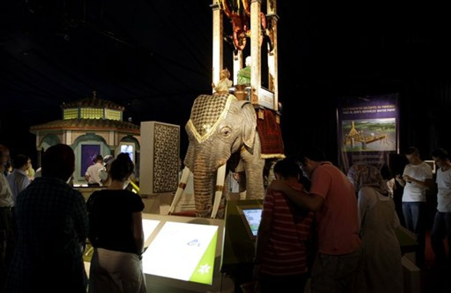 "In this photo of Monday Aug. 23, 2010 visitors view a piece at the ""1001 Inventions"" exhibit in Istanbul, Turkey. The exhibition about innovation in Muslim civilization seeks to highlight what organizers say is an overshadowed period of history, a ""Golden Age"" in which advances in engineering, medicine and architecture laid groundwork for Western progress from the Renaissance until modern times. (AP Photo/Ibrahim Usta)"