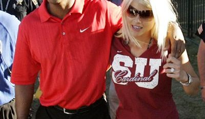 This photo taken Nov. 21, 2009 shows Tiger Woods, his  daughter Sam Woods and wife Elin Nordegren, before a NCAA college football game in Stanford, Calif.  Woods and his wife are officially divorced. The lawyers for Woods and Nordegren said in a statement that the divorce became official Monday  Aug. 23, 2010, in Bay County Circuit Court, in Panama City, Fla. (AP Photo/Marcio Jose Sanchez)