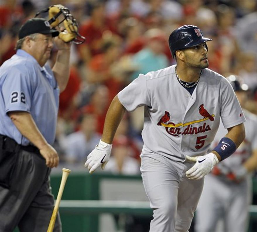St. Louis Cardinals' Albert Pujols watches his 400th home run in the fourth inning of a baseball game with the Washington Nationals at Nationals Park in Washington Thursday, Aug. 26, 2010. (AP Photo/Alex Brandon)