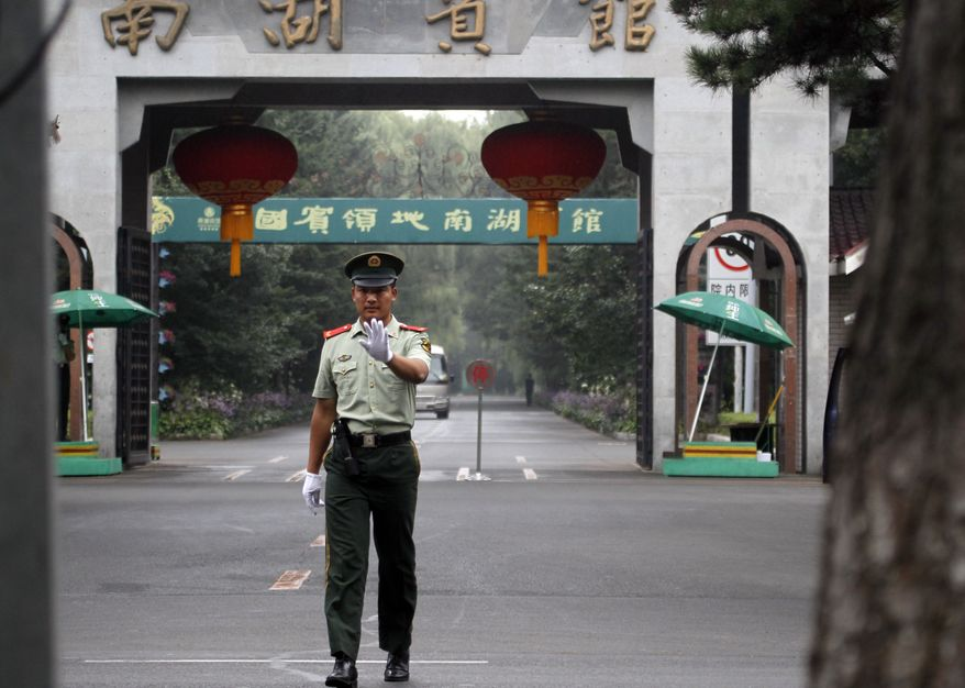 A Chinese paramilitary police man gestures for a photographer to stop shooting pictures outside the Nan Hu hotel where North Korean leader Kim Jong-il is believed to be staying after he arrived at Changchun in northeastern China's Jilin province on Friday, Aug. 27, 2010. North Korean dictator Kim Jong Il was said to be traveling with his youngest son on a rare trip to China on Friday, re-igniting speculation the younger Mr. Kim will take over the reigns of the reclusive communist nation in coming years. (AP Photo/Ng Han Guan)