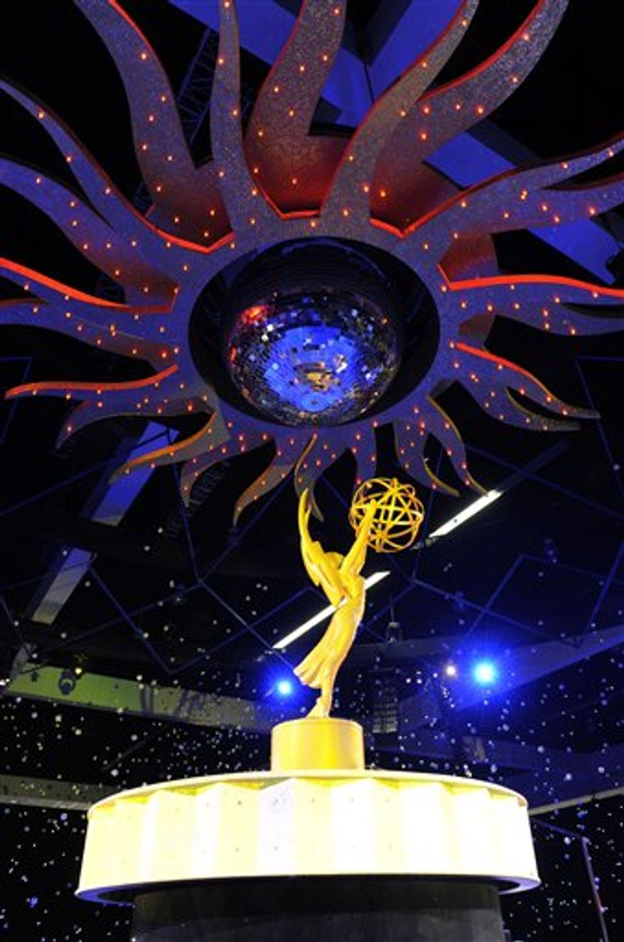 An Emmy statue is displayed inside the Governors Ball following Sunday's 62nd Primetime Emmy Awards, during Emmy Awards Press Preview Day in Los Angeles, Wednesday, Aug. 25, 2010. (AP Photo/Chris Pizzello)