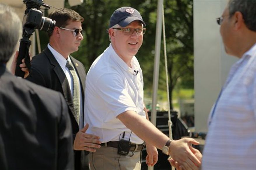 Glenn Beck, center, shakes hands with supporters at the site of the Restoring Honor rally by the Lincoln Memorial in Washington, on Friday, Aug. 27, 2010.  The rally will take place on Saturday. (AP Photo/Jacquelyn Martin)