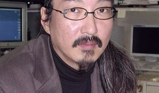 "In this photo taken in 2003, Japanese animation film director Satoshi Kon sits in his office in Tokyo. Kon, known for ""Tokyo Godfathers,"" ""Millennium Actress,"" and other prize-winning films, died of pancreas cancer Tuesday, Aug. 25, 2010. He was 46. (AP Photo/Kyodo News)"