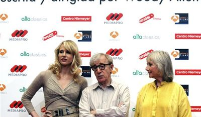 British actress Gemma Jones, right, U.S. film maker Woody Allen, center, and British actress Lucy Punch left, attend 'You Will Meet a Tall Dark Stranger' Photocall, in Gijon, Spain, Tuesday, Aug. 24, 2010. (AP Photo/Juan Avellaneda)