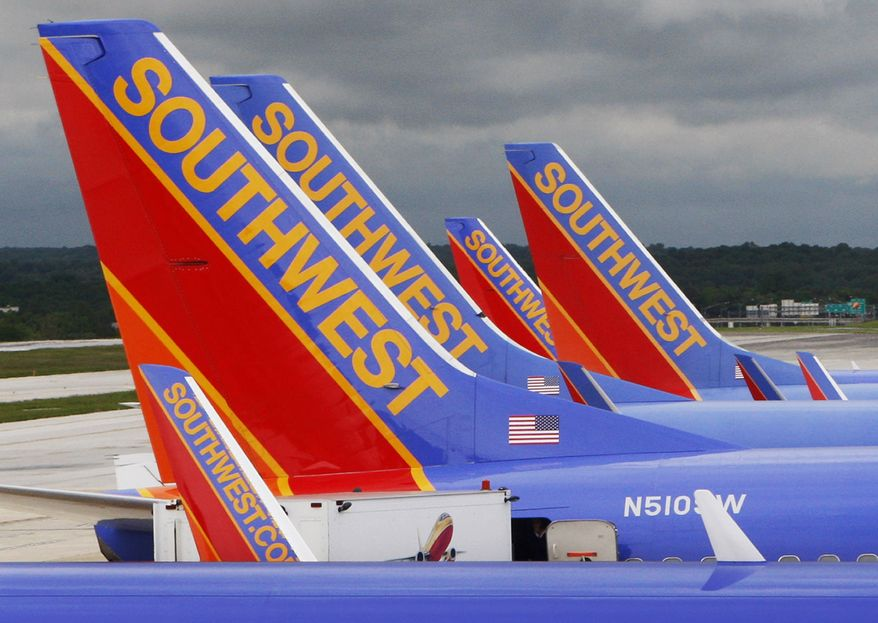 FILE - In this file photo taken May 16, 2008, Southwest Airlines jets are seen parked at their gates at Baltimore Washington International Airport in Baltimore. United and Continental will help Southwest Airlines Co. expand in the New York market to help clear a path to their own combination, which would create the world's biggest airline. United and Continental said Friday, Aug. 27, 2010, they would lease takeoff and landing slots at Newark (N.J.) Liberty International Airport to Southwest beginning next March. (AP Photo/Charles Dharapak, file)