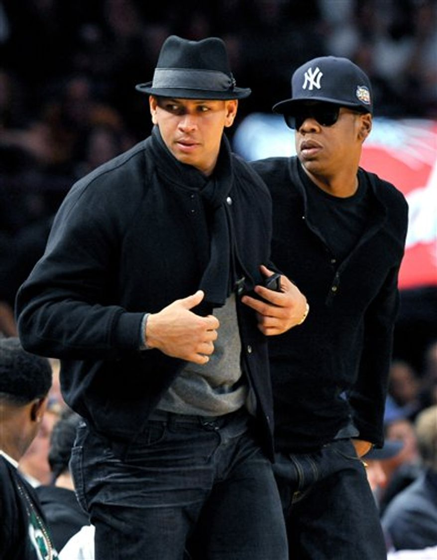 In this Nov. 6, 2009, photo, New York Yankees' Alex Rodriguez, left, and hip-hip mogul Jay-Z stand during an NBA basketball game between the New York Knicks and the Cleveland Cavaliers in New York. Jay-Z is teaming up with his favorite baseball squad on co-branded clothes that will be sold exclusively at Yankee Stadium beginning next week. All the items, from baseball caps to T-shirts and hooded sweat shirts, will feature Yankees and Jay-Z logos. (AP Photo/Kathy Kmonicek)