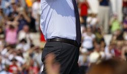 Glenn Beck waves as he arrives to speak at his  'Restoring Honor' rally in front of the Lincoln Memorial in Washington, Saturday, Aug. 28, 2010.(AP Photo/Alex Brandon)