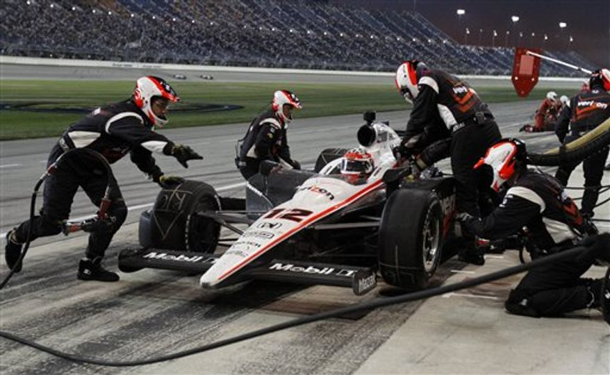 Will Power, of Australia, makes a pit stop during the IndyCar Series auto race at ChicagoLand Speedway in Joliet, Ill., Saturday, Aug. 28, 2010. (AP Photo/Nam Y. Huh)