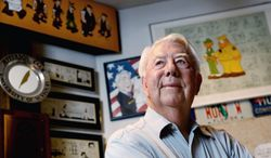 """Mort Walker, the artist and author of the """"Beetle Bailey"""" comic strip, stands in his studio in Stamford, Conn. (Associated Press)"""