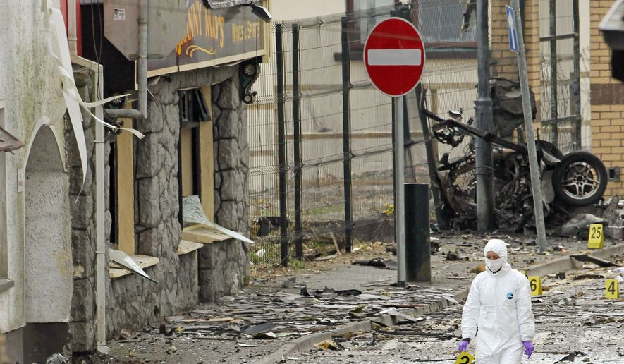 Wreckage is scattered across a street in Armagh, Northern Ireland, after a car bombing outside a police station in April, as tensions between Catholics and Protestants increased. (Associated Press)