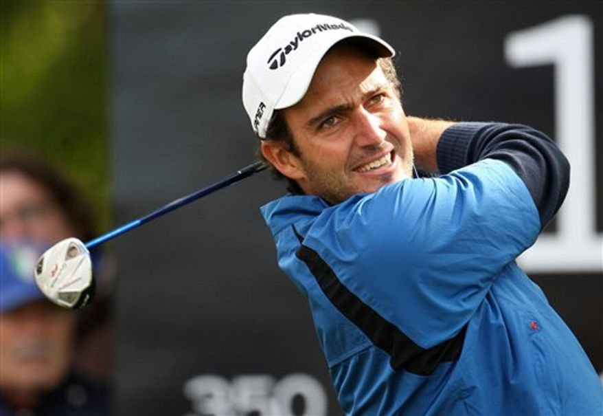 Italy's Edoardo Molinari kisses the trophy after winning the Johnnie Walker Championship at Gleneagles, Scotland, Sunday Aug. 29, 2010.  (AP Photo / Lynne Cameron/PA)
