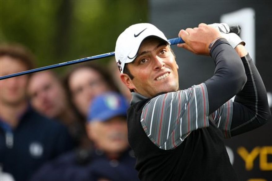 Italy's Francesco Molinari hits a shot during day four of the Johnnie Walker Championship at Gleneagles, Scotland, Sunday Aug. 29, 2010.   (AP Photo / Lynne Cameron/PA)