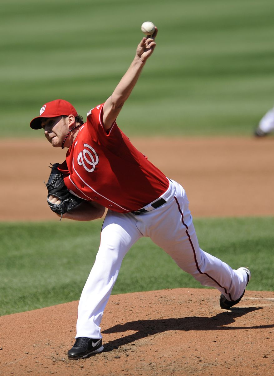 ASSOCIATED PRESS Washington Nationals starter John Lannan  delivers a pitch against the St. Louis Cardinals during the third inning of a baseball game Sunday, Aug. 29, 2010, in Washington.