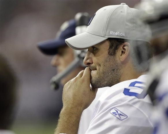 Houston Texans quarterback Matt Schaub (8) looks for a receiver as Dallas Cowboys linebacker DeMarcus Ware (94) moves in during the third quarter of an NFL football game Sunday, Sept. 26, 2010, in Houston. The Cowboyws won 27-13. (AP Photo/David J. Phillip)