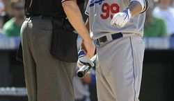 Los Angeles Dodgers' Manny Ramirez, right, argues a called strike with home plate umpire, Gary Cederstrom, who ejects Ramirez in the sixth inning of a baseball game against the Colorado Rockies at Coors Field in Denver, Colo. on Sunday, Aug. 29, 2010.  (AP Photo/ Matt McClain)