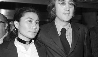 FILE - In this March 16, 1972 file photo, John Lennon and Yoko Ono leave a brief deportation hearing in New York at the offices of the Department of Immigration and Naturalization. Yoko Ono is planning a series of events in Iceland to mark what would have been John Lennon's 70th birthday. The artist and peace campaigner will light the Imagine Peace Tower illuminated memorial, located on the island of Vioey near Icelandic capital Reykjavik, on Oct. 9, 2010.  (AP Photo/Tony Camerano, File)
