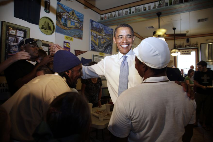 President Obama greets patrons and staff at the Parkway Bakery and Tavern in New Orleans on Sunday, Aug. 29, 2010, the fifth anniversary of Hurricane Katrina. (AP Photo/Carolyn Kaster)