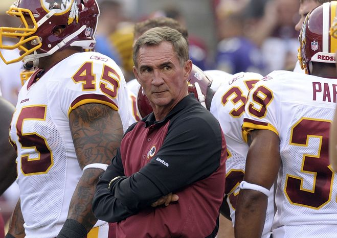 ASSOCIATED PRESS FILE - In this Aug. 21, 2010, file photo, Washington Redskins head coach Mike Shanahan watches warm ups before a preseason NFL football game against Baltimore Ravens in Landover, Md.