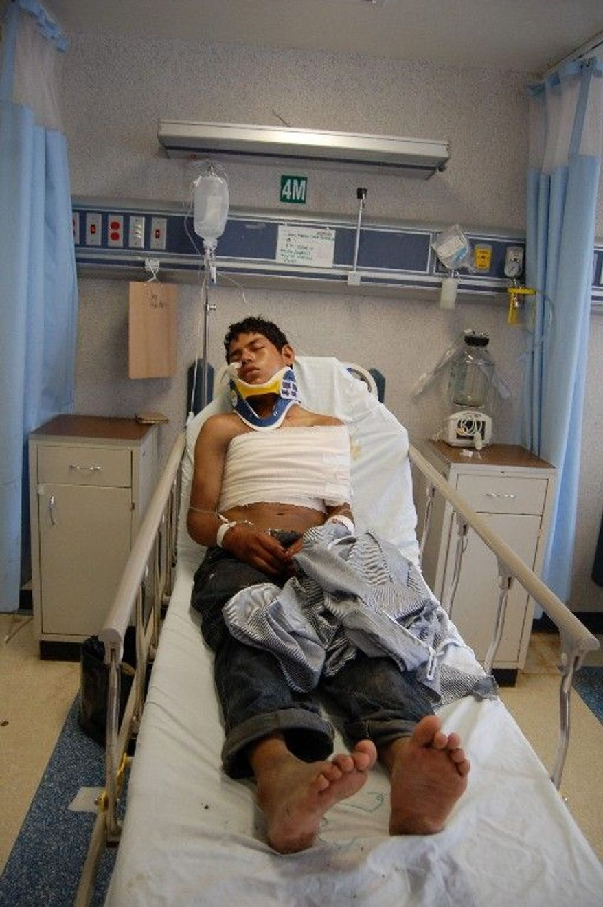Luis Fredy Lala Pomavilla, an Ecuadorean citizen who survived a massacre that left 72 Central and South American migrants dead at a ranch 100 miles south of the U.S.-Mexican border, rests at a hospital in Matamoros on Aug. 24. He said the killers said they belonged to the Zetas drug cartel. (Associated Press)