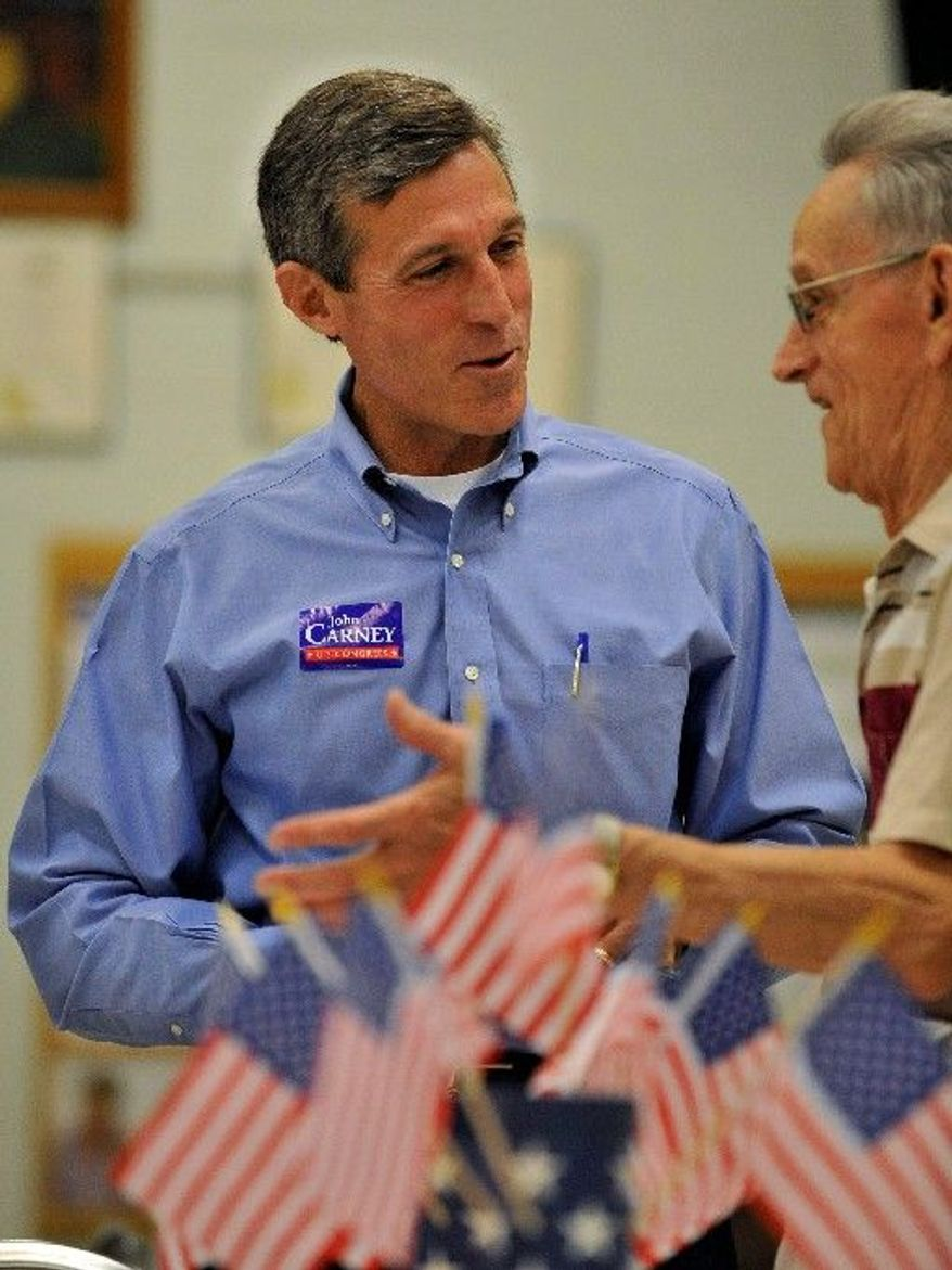 """ASSOCIATED PRESS John Carney, a Democratic candidate for the House in Delaware, talks with Lou Best at a senior center in Wilmington, Del. """"I'll support [President Obama] when I think he's right,"""" he said."""