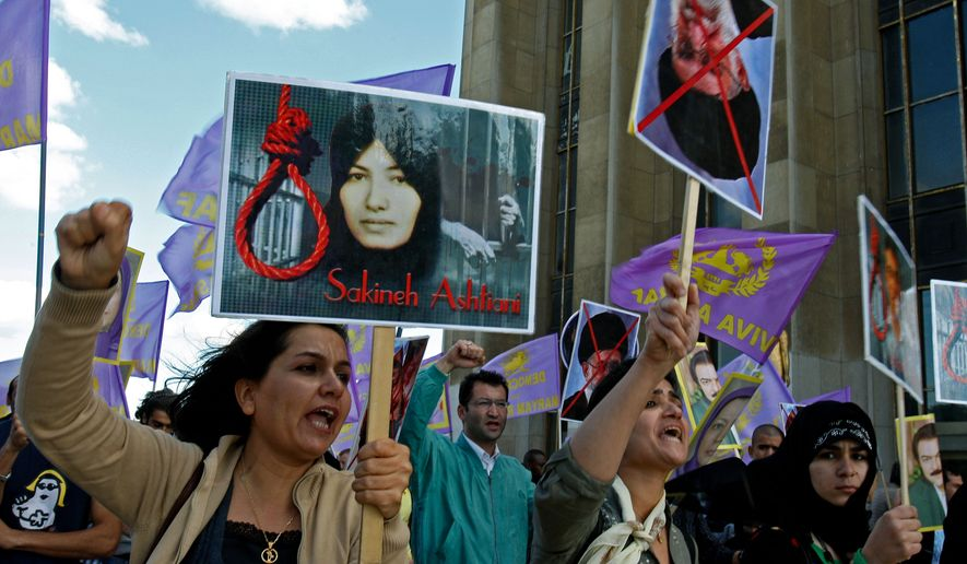 Supporters of National Council of Resistance of Iran in France protest the death sentence of Sakineh Mohammadi Ashtiani, at Trocadero square in Paris, Saturday, Aug. 28, 2010. Ms. Ashtiani, a 43-year-old mother of two, was sentenced to death by stoning for adultery. (AP Photo/Michel Euler)