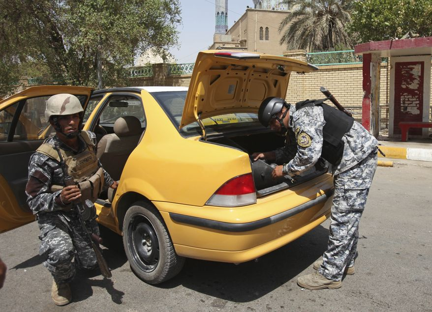 Iraqi policemen search a car at a checkpoint in Baghdad Sunday, Aug. 29, 2010. While violence in Iraq has subsided significantly since the height of the sectarian bloodshed in 2006 and 2007, militants continue to target members of Iraq's nascent security forces, undermining their ability to defend the country as the U.S. ends combat operations. (AP Photo/Karim Kadim)